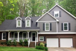 Gray painted house with siding