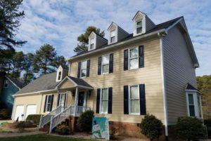 Tan house with siding