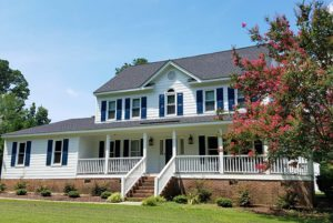 White painted house with siding